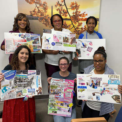 Military caregivers pose with 2020 vision boards
