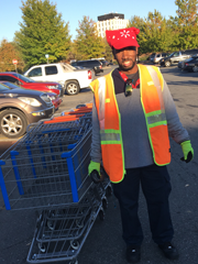 Man with walmart carts outside