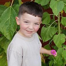 GPCDC kid with flower