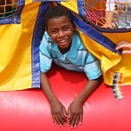 Boy in Jumping Castle Ad Size