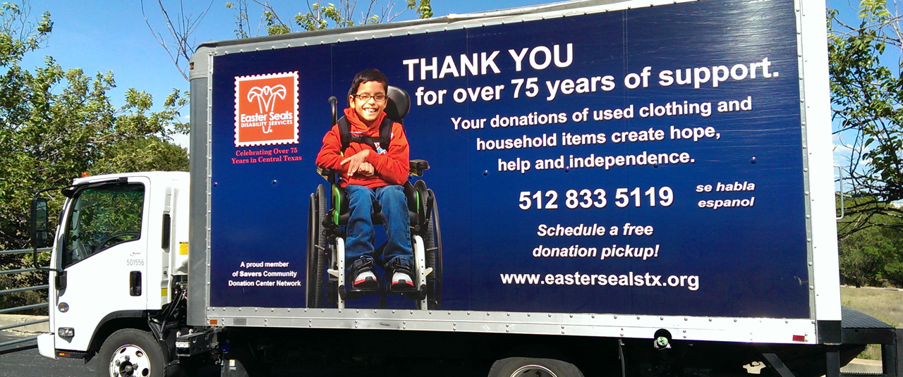 picture on the side of a box truck of a little boy in a wheelchair