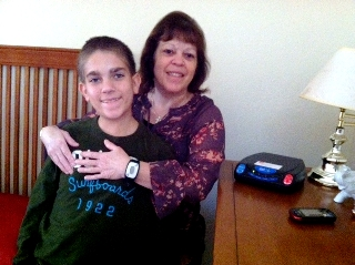PERS subscriber Janet with her son smiling