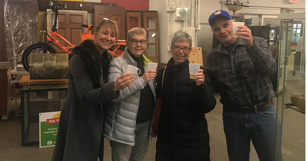 TJ and Carol join in a champagne toast at the bike raffle with Lauran McHaffie, Easterseals Annual Giving Leader, and David Rich, Director of Building Value.