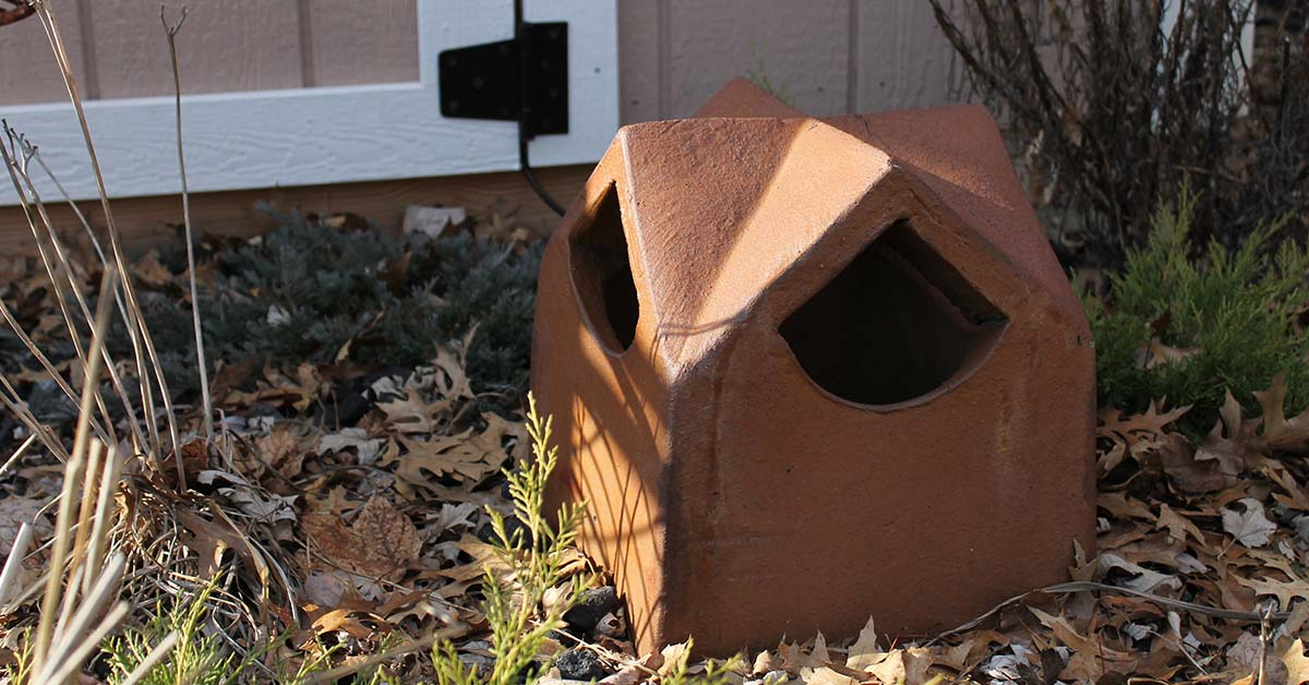 This old chimney topper has become a garden refuge for birds and small animals.
