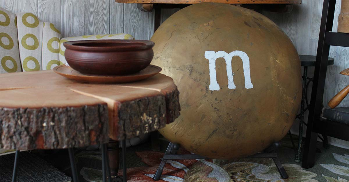 This giant metal M&M candy has become one of Carol and TJ's most treasured discoveries at Building Value. It's so heavy, they had to have a custom stand built to display it!