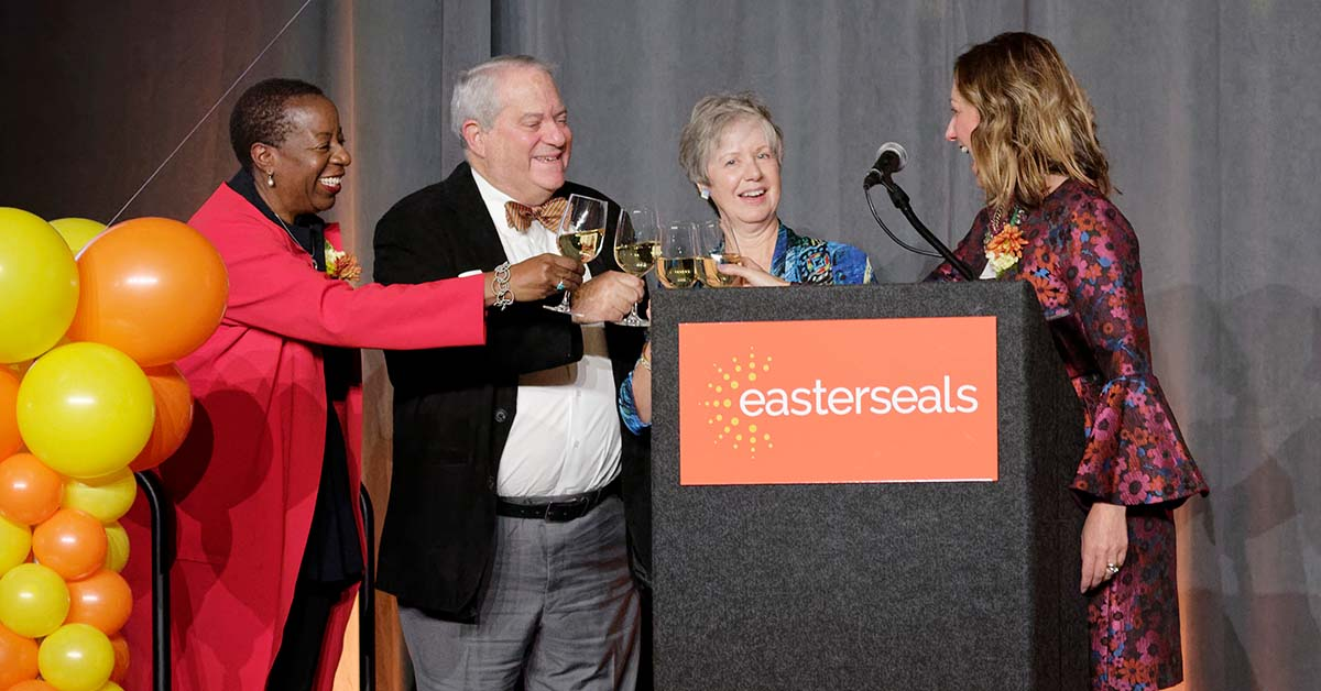 Angela Williams, President & CEO of Easterseals National, Peter Bloch, former President & CEO of Jewish Vocational Services, Lisa FitzGibbon, former President & CEO of the Work Resource Center, and Pam Green, President & CEO of Easterseals Serving Greater Cincinnati, join in a toast to 100 Years of Easterseals.
