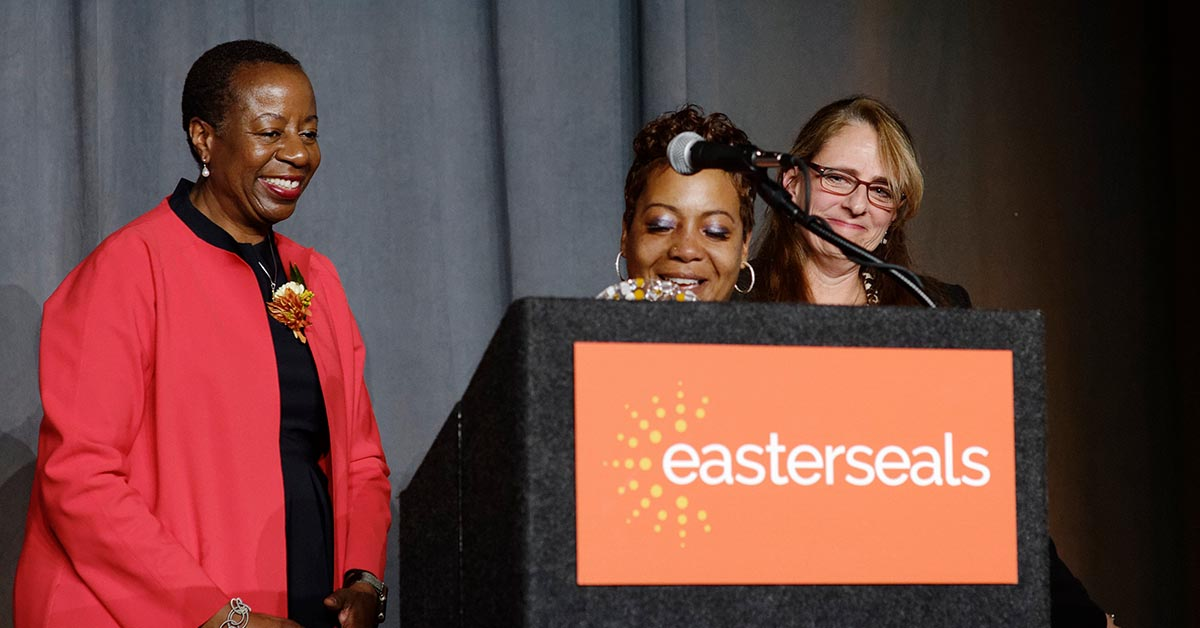 Yalonda Render accepts the Spirit of Easterseals Award, presented by Easterseals National President Angela Williams (left) and Easterseals Serving Greater Cincinnati Board member Jessica Rappaport (right). Yalonda went through Easterseals' Prosperity for All and now has a career as a phlebotomist with Cincinnati Children's.