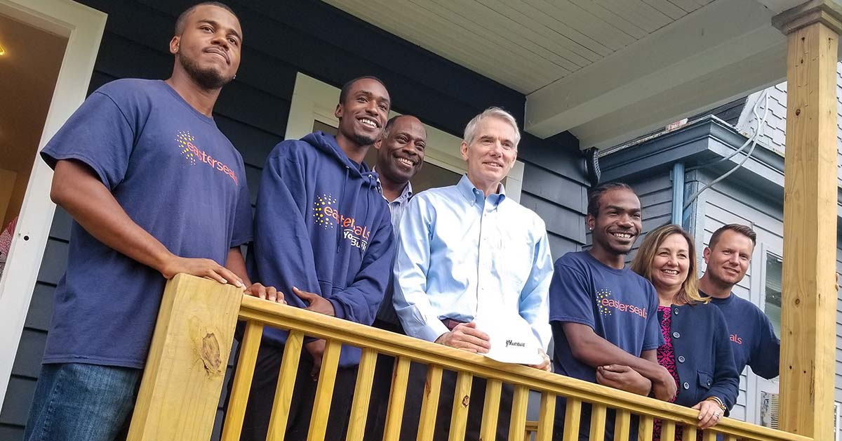 Easterseals YouthBuild participants lead Ohio Sen. Rob Portman on a tour of their completed house renovation in Evanston in August 2019.