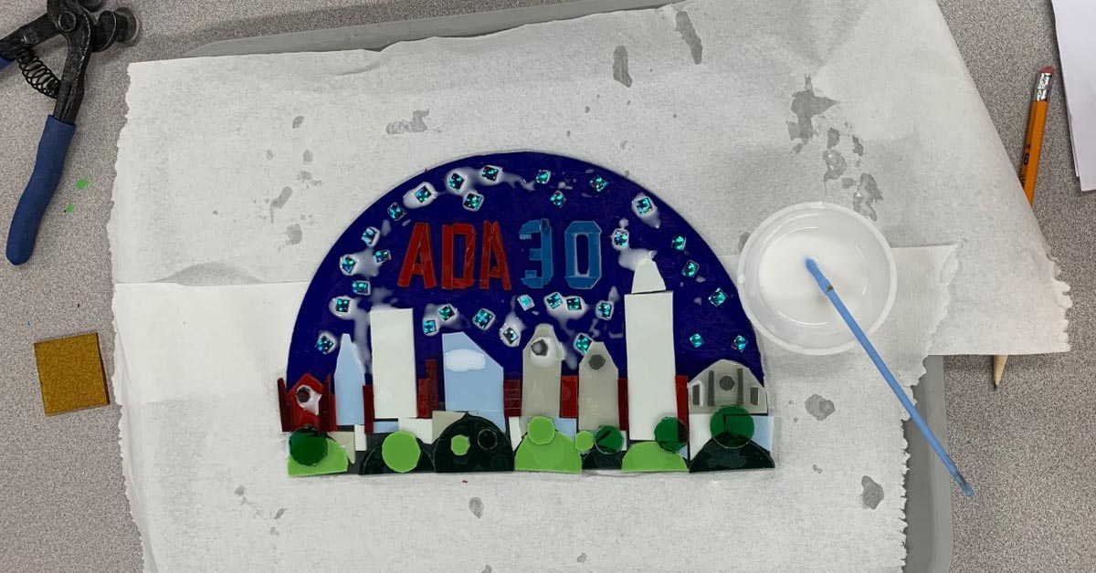 The glass pieces for the ADA 30 awards are glued into place and ready for the kiln.