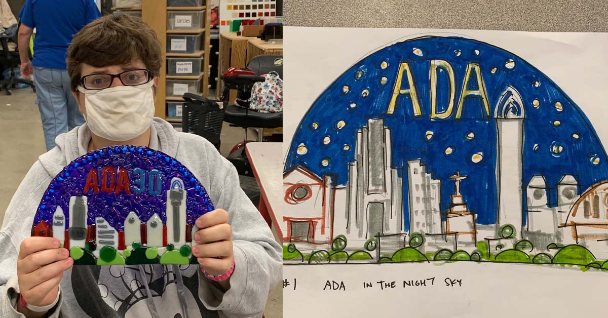 Ashley Parris, who worked on the awards with fellow InsideOut Studio artists, proudly displays the finished creation.