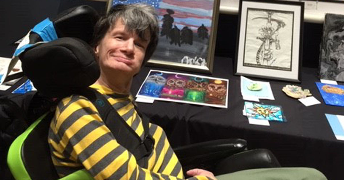 Easterseals Adult Day Services Participant posing in front of art collection