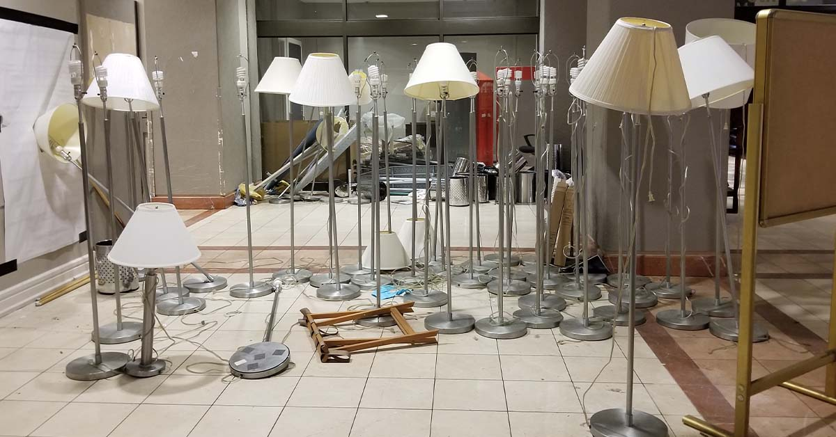 A collection of floor lamps awaits recycling.