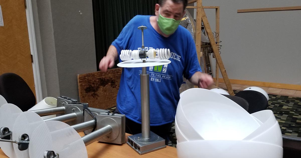Steve prepares hotel lamps for recycling by removing the shades and bulbs.