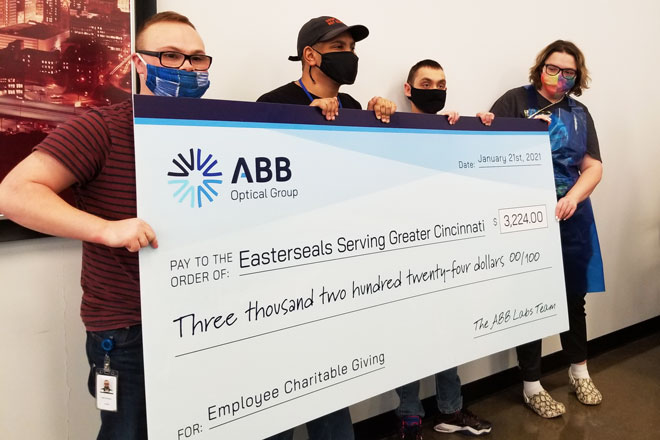 ABB Optical employees Sabin, Britton, Jacob, and Angel present a fundraising check to Easterseals Serving Greater Cincinnati.