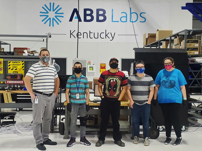 Jason Schweitzer, ABB Optical Human Resources Manager, with employees Jacob, Britton, Sabin, and Angel.