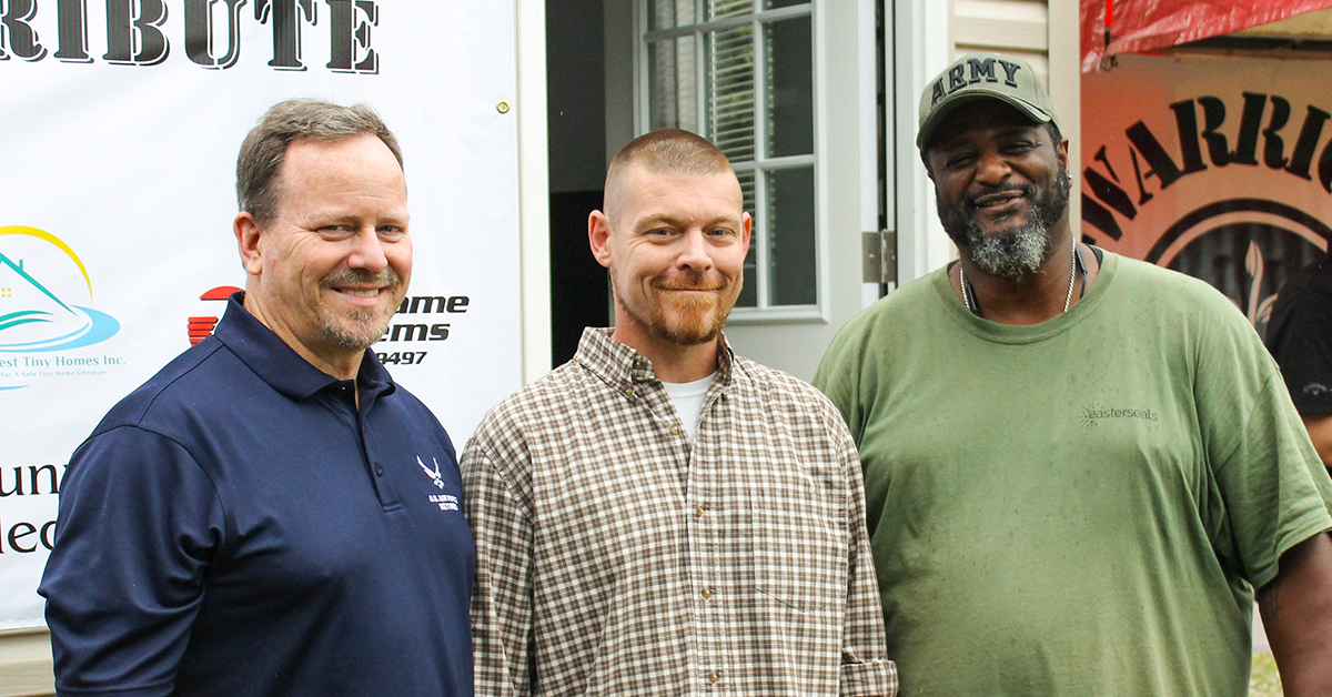 Easterseals Military and Veterans Services Director Scott Robinson (left) and job specialist Chris Macklin (right) with Adam Davis.