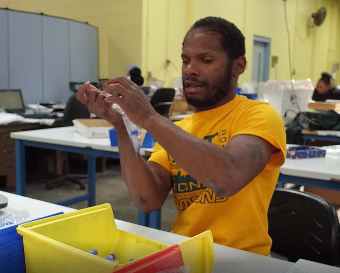 Mario Thomas working in Easterseals Production & Fulfillment Center