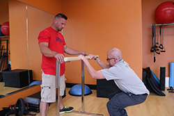 Dave working out with parallel bar