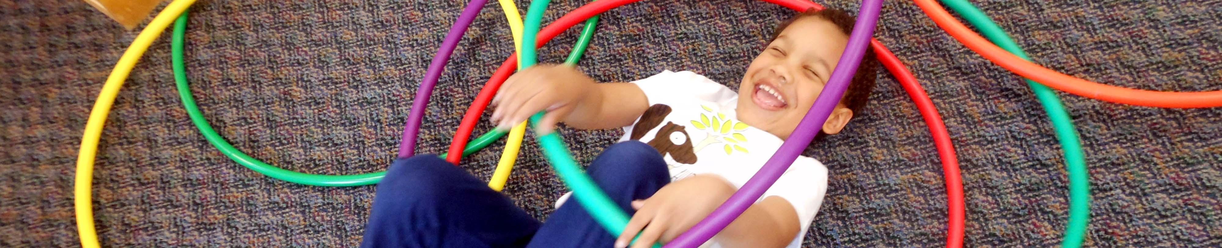 Boy with hoola hoops