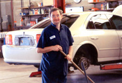 A client of New Frontiers Employment Services works in a car shop.