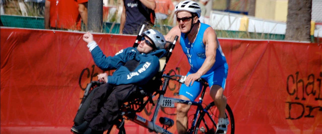 father and his son with a disability in a bike race