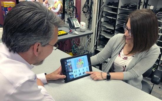 Kristi and Eric Oddliefson using an ipad