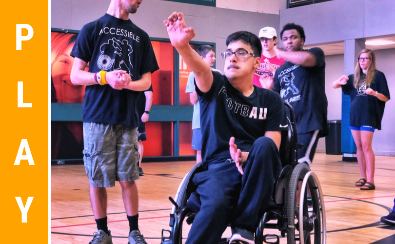 adolescent in wheel chair doing martial arts hand strike