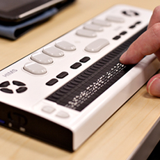Image of fingers typing on HIMS braille note taker