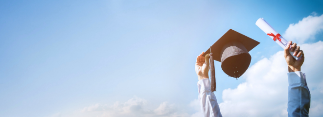 A blue sky. Two arms protrudes from the bottom of the frame, one holding a graduation cap, and the other holding a rolled up diploma.