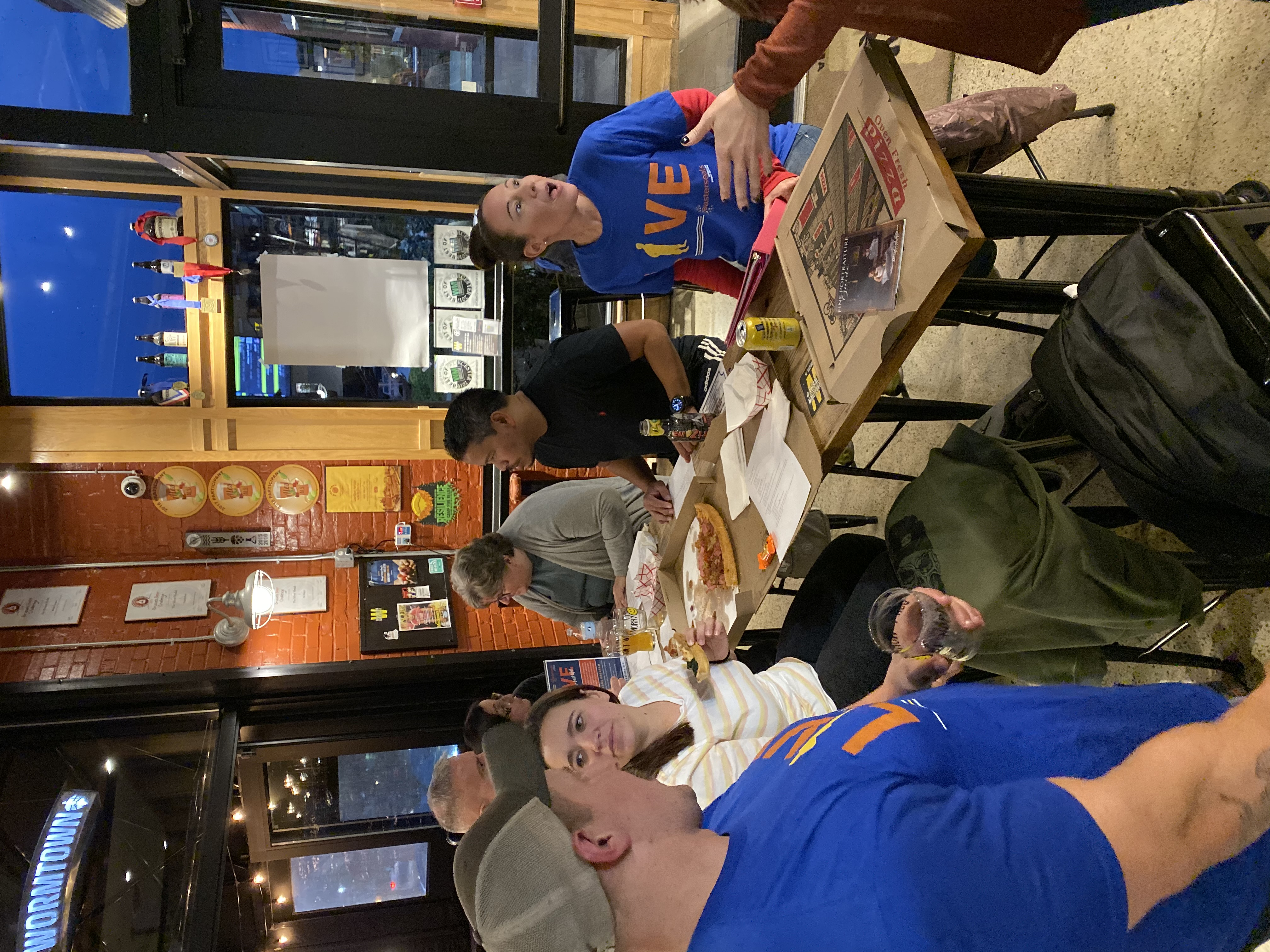 Jake Webb and other veterans sitting at a table inside a brewery, wearing Team Live T-shirts