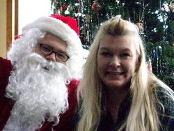 Santa and party-goer smile for the camera