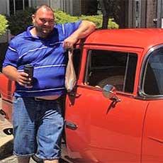 Man with car at car show
