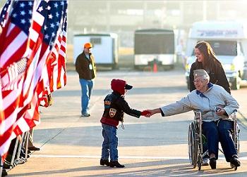 veteran shaking child's hand
