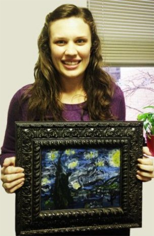 Nicole stands with painting by Jarrod, Easter Seasl North Texas CLASS client
