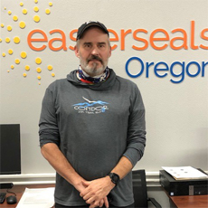 Robert Swan, an HVRP participant, posed in front of the Easterseals Oregon sign.
