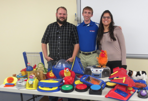 Volunteers with adaptive toys