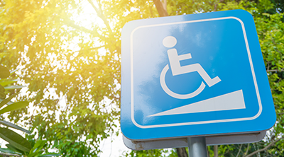 A sign with the accessibility symbol - an figure of a person in a wheelchair