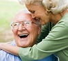 A woman hugging a smiling man