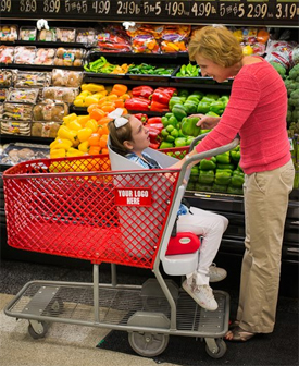 Caroline Long in a Caroline's Cart at a grocery store