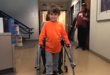 child using a walker