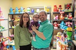 Heather Bennett, her husband and, daughter Katelyn in toy closet