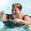 A woman swimming at an Easterseals camp