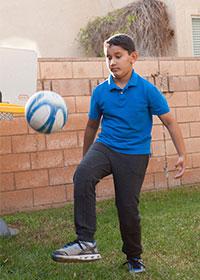 Photo of Adam playing Soccer