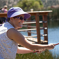 Camp 2018 website photo 2 of a woman fishing