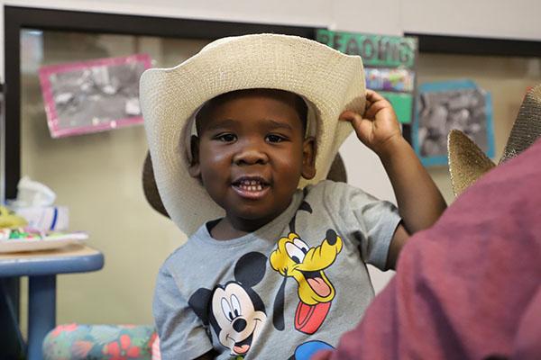 African American boy wearing cowboy hat 600x400