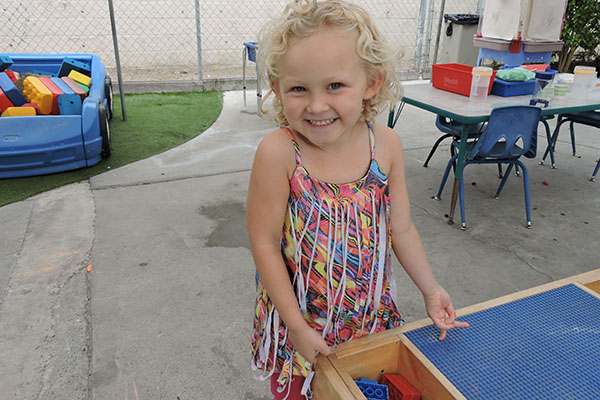 CDC Blond girl at play table