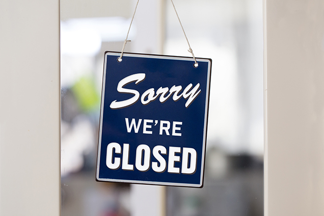Graphic of a sign that says sorry we're closed