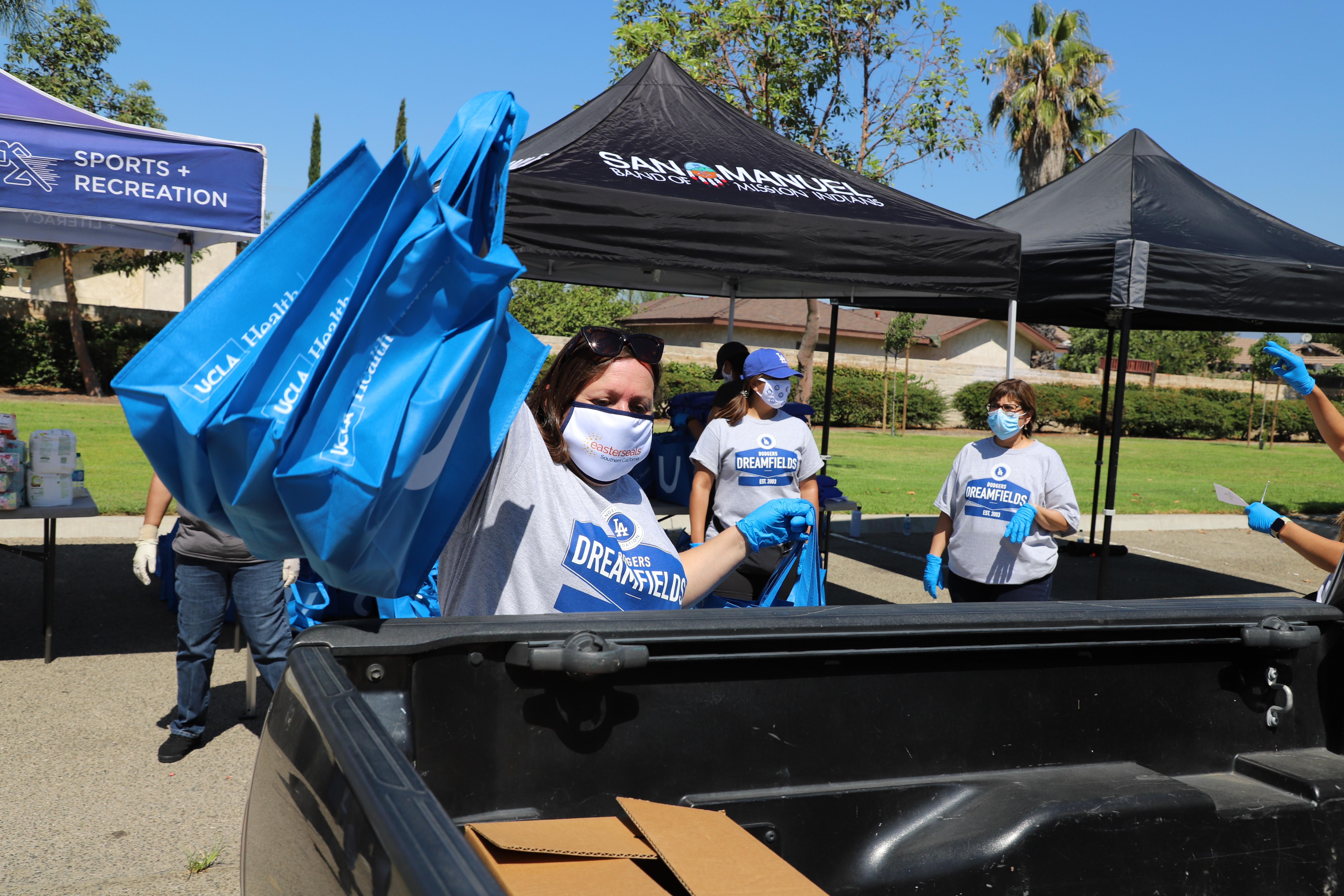 Volunteers handing out bags
