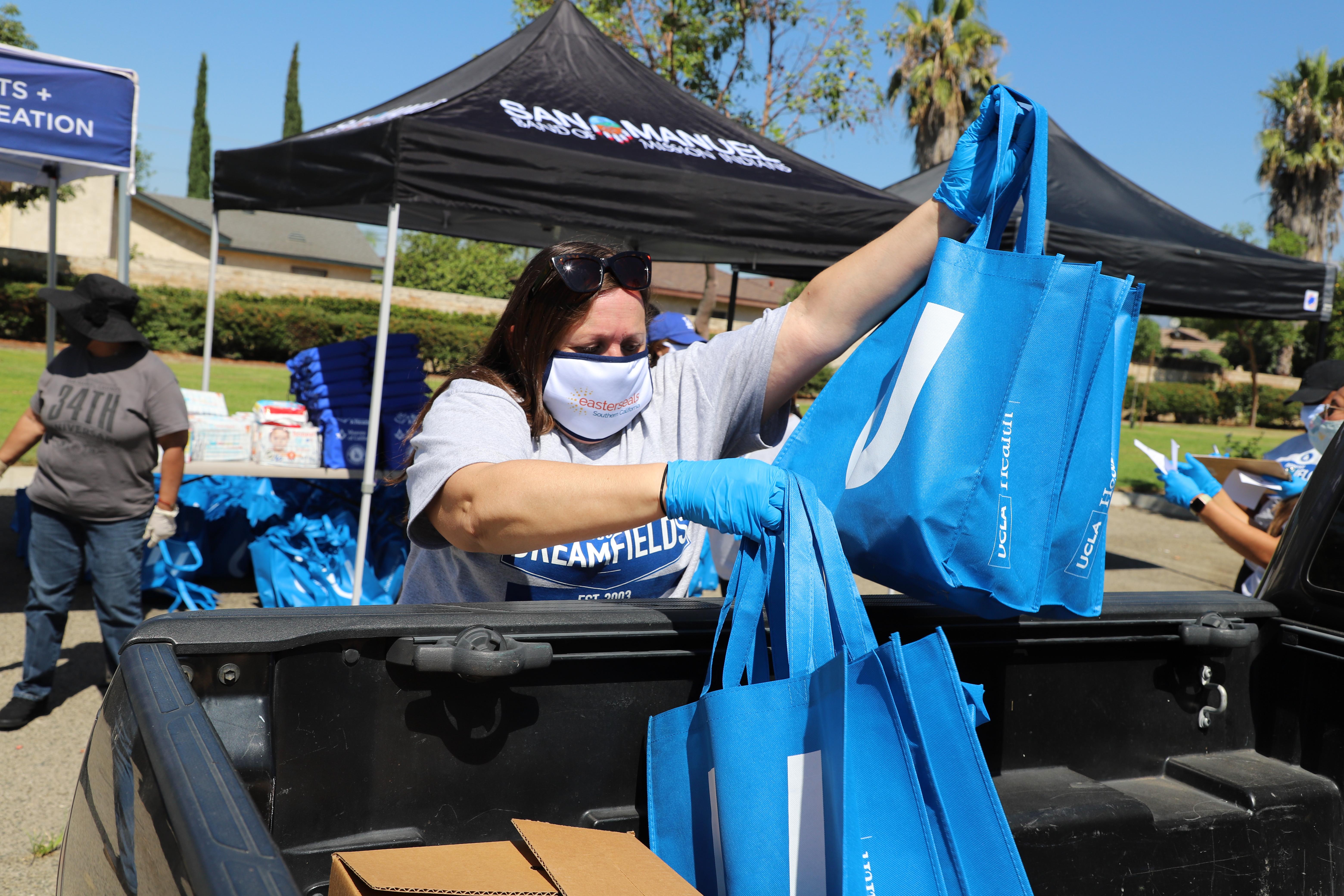 Volunteer handing out bags