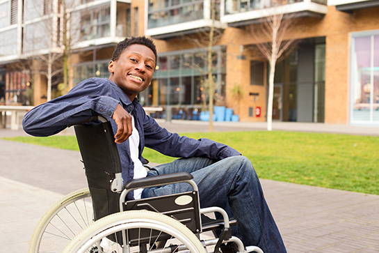 Smiling Man Sitting In Wheelchair